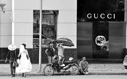 A changing Vietnam, western luxury goods alongside poverty