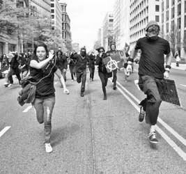 Protesters running in street during a demonstration
