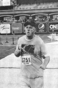 FE's Bill Blank, wearing a Free Marie t-shirt, crosses the finish line at the Indianapolis Half-Marathon