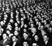 Audience viewing a 3-D movie wearing special glasses