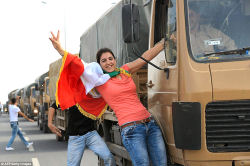 A Kurdish woman from Turkey on a peshmerga military vehicle