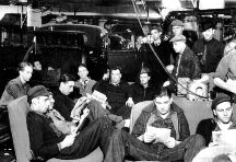 UAW workers engage in a sit-down strike against GM in Flint, Michigan, 1937