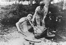 "A scene from ""The Good War"": American marines boil the flesh off of a Japanese soldier's skull, Guadalcanal, South Pacific, 1942."