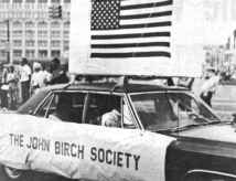 Image, pro-war march, Detroit, July 1967, John Birch Society, was represented by a 1967 four door, air-conditioned Cadillac Fleetwood.