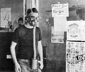 photo, Fifth Estate staffer Peter Werbe wears protective mask after offices gassed by national guard, July 1967