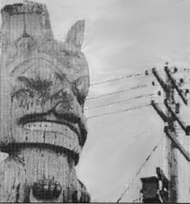 "photo of totem pole and telephone pole, accompanying article ""Potlatch: Ritual Resistance to Capitalism"""