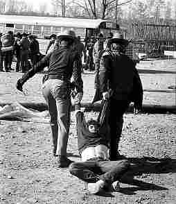 photo, police dragging anti-nuclear peaceful protester to bus, Seabrook, NH, 1977