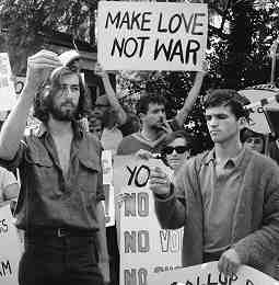 "Anti-Vietnam War protest, April 27, 1968. Photo shows draft registration cards being burnt, one sign reads ""Make Love Not War!"""