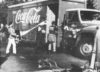 photo, Coca-Cola truck being trashed by anarchists