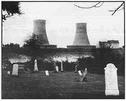photo: Twin cooling towers at the Fermi Nuclear Facility loom over a Monroe County graveyard. photo/Steven Benson