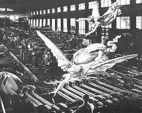 Collage by Freddie Baer, shows large predatory winged creature soaring over a large factory interior