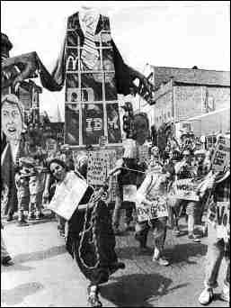 Photo showing street demonstration with giant puppets