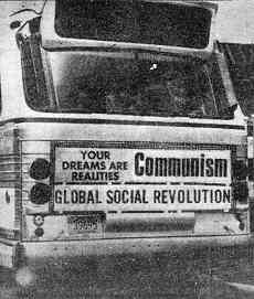 "photo shows rear bus poster reading ""Your dreams are realities: Communism / Global social revolution. See ""Detroit Seen"" column in issue 293-294."
