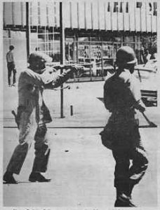 Photo showing 2 National Guardsmen aiming rifles, Berkeley, May 1969.