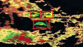 A computer-generated image shows 2 eyes above a mouth, each framed by a red rectangle, against a background of shapes which, in the videos, pulsate and move in relation to the accompanying sound .
