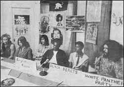 Photo shows six people seated as a panel at a long table.