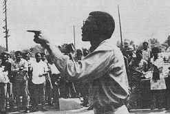 Photo shows Ron March, DRUM leader, addressing an outdoor rally.