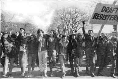"""Anti-war march, Washington, November 15, 1969. Photo shows a group of protesters; a sign reads, Draft Resisters."""""""