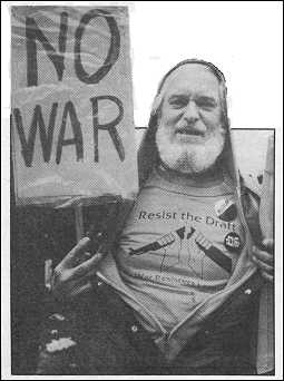 """photo of Victor D. Schumacher holding a large """"No War"""" sign."""