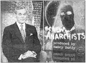 "Photo shows a suited male news anchor next to an illustration of a figure in balaklava. Label reads ""Thee New Anarchists produced by Nancy Duffy."""