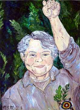 Marius Mason, smiling portrait with raised fist