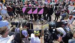 Photo shows protesters, some bearing black and pink shields.