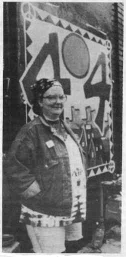 A photo showing a smiling Carla Glidden standing in front of the 404 Space in Detroit