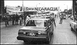 "photo shows street protest with banners reading, ""U.S. Out of Nicaragua"" etc."