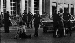 Photo shows Police arresting and threatening mobile blockaders at Rock Island Army Arsenal June 4, 1984