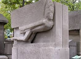 A color photo shows Oscar Wilde's monument in Pere Lachaise Cemetary in Paris.