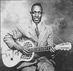 A photo of Peetie Wheatstraw playing guitar